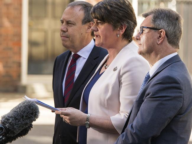 Democratic Unionist Party (DUP) leader Arlene Foster, center, DUP Deputy Leader Nigel Dodds, left, and DUP MP Jeffrey Donaldson make a statement to the media outside 10 Downing Street. Picture: AP.