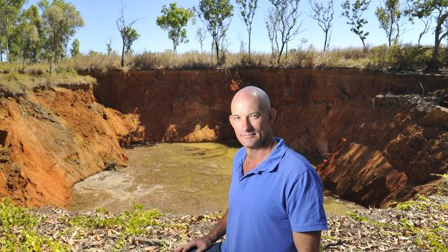 A massive hole opened up on this man's Darwin property last year. Picture: Helen Orr