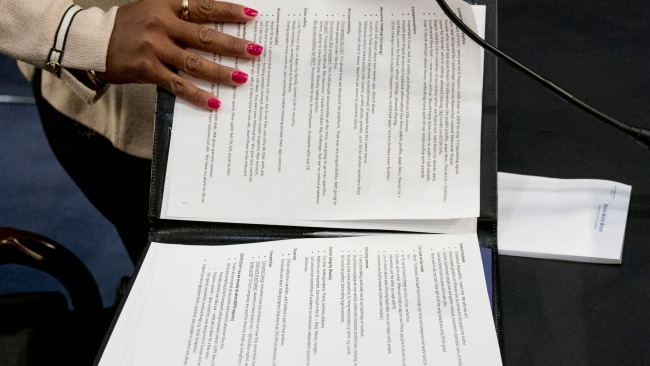 An aide realised Zuckerberg had left his notes open, but not before a photographer snapped a shot of them. (AP Photo/Andrew Harnik)