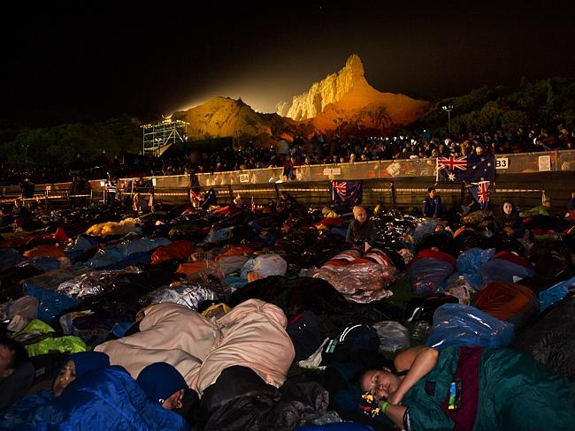 Pre dawn ... Australians and New Zealanders sleep ahead of the Anzac Day dawn service at