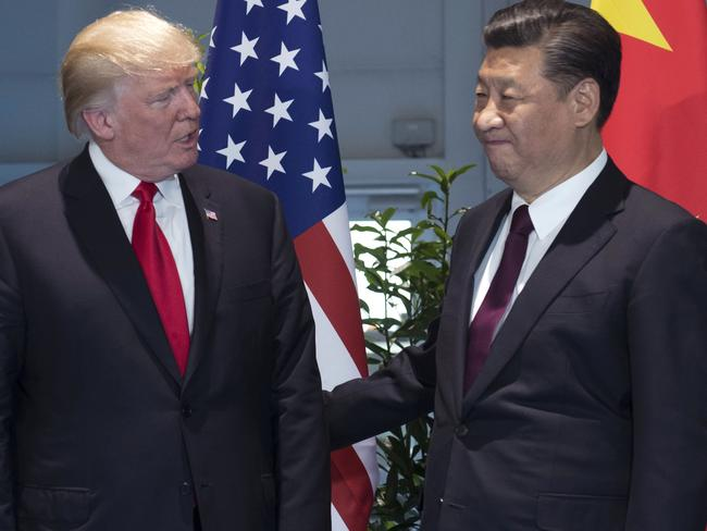 Donald Trump, left, and China's President Xi Jinping arrive for a meeting on the sidelines of the G-20 Summit. Picture: Saul Loeb/Pool Photo via AP