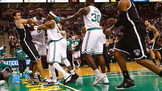 Boston players Kevin Garnett, Jason Terry and Rajon Rondo push Brooklyn's Kris Humphries into the crowd as the two sides sparked an all-in brawl.