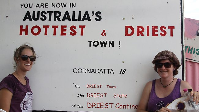 The message is clear: Roadtrippers Nikki Staskiewicz and Angela Blomeley cooling down as they wait for the bowsers at Oodnadatta to open Picture: Daniels Anna