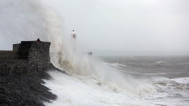 Waves batter the sea barriers in Porthcawl, south Wales.