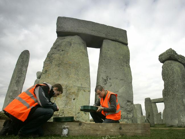 Archaeology students sieve through earth among the stones at Stonehenge, March 2008.