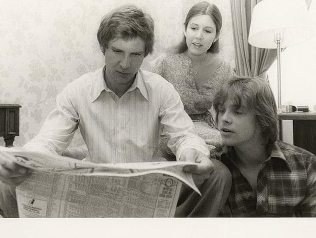 Fisher, Ford and Mark Hamill on the set of a Star Wars film. The movie made them household names. Picture: Carrie Fisher personal collection