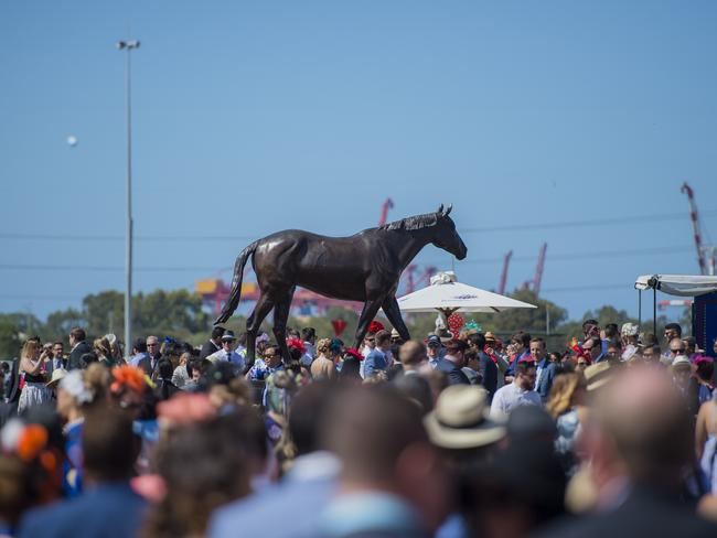 The statue of three-time Melbourne Cup winner Makybe Diva is a popular place on the Flemington lawn. Picture: Jason Edwards