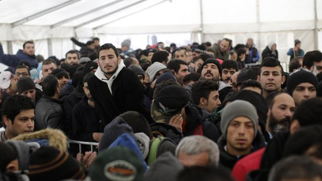 Hundreds of migrants waits in a tent to continue their registration process at the central registration centre, the State Office for Health and Social Affairs in Berlin. (Photo: Markus Schreiber/AP)