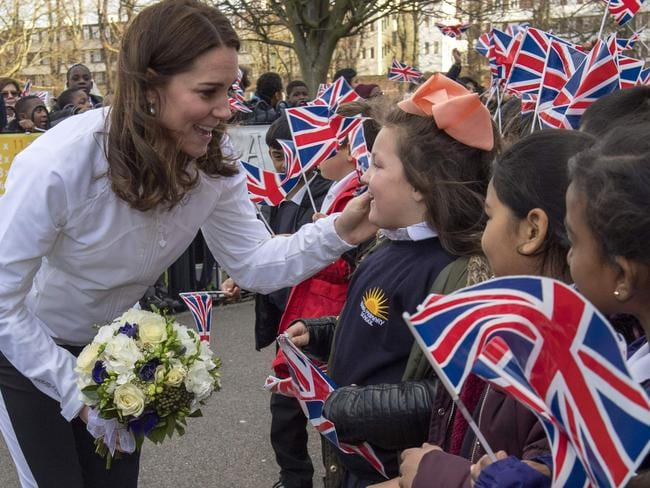 The Duchess was given a bouquet of flowers from students at Bond Primary School. Picture: AFP
