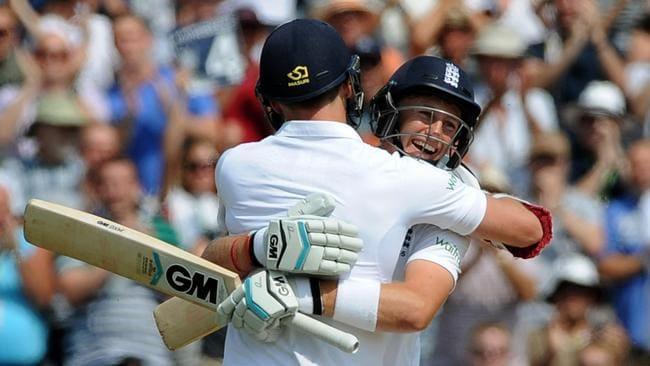 England's Joe Root, right, celebrates with James Anderson after reaching a century during day four of the first test between England and India at Trent Bridge.