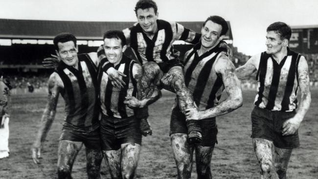 Murray Weideman (left) and his Collingwood teammates after the 1958 grand final.