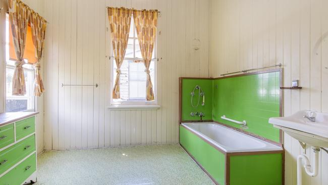 It doesn't get more vintage than a large green bathroom in this New Farm property for sale.