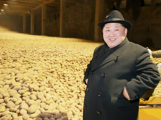 The cybery attacks could help prop up Kim Jong-un's, pictured here at a potato production factory, failing economy. Picture: KCNA/AFP