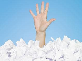 23/01/2012 BUSINESS: Human buried in papers, drowning in debt. Pic. Thinkstock Supplied