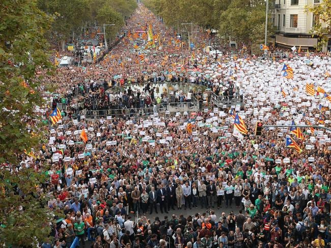 Protesters hold up signs to demand the release of imprisoned Catalan leaders Jordi Sanchez and Jordi Cuixart at a demonstration for Catalan independence. Picture: Getty