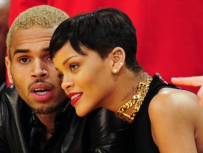 Rihanna and Chris Brown attending an NBA game in December 2012.