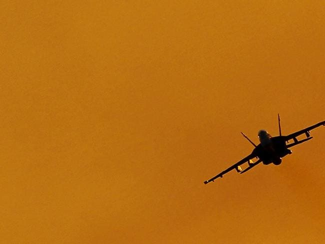 Game over ... A No. 1 Squadron F/A-18F Super Hornet performs a handling display over Mindil Beach in Darwin. Source: Defence