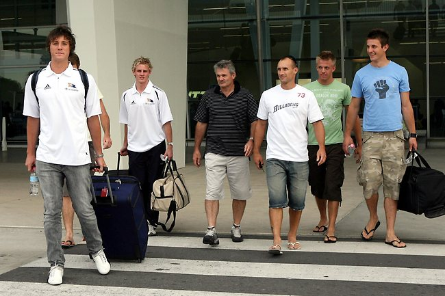 Draftees Kurt Tippett (left), David Mackay are met by Crows coach Neil Craig and players Tyson Edwards and Ivan Maric after arriving in Adelaide. Picture: Ray Titus