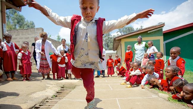 Hennock, 5, plays with friends at his Plan-supported kindergarten in Addis Ababa, Ethiopia. Picture: Richard Wainwright/Plan Australia