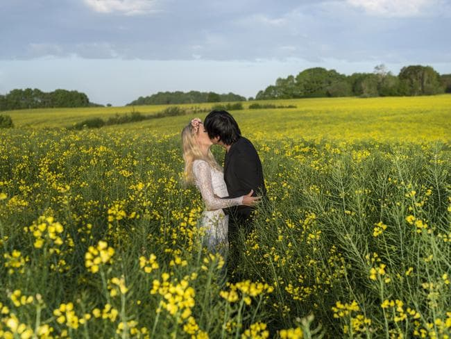 Here's one for the Sound of Music fans. Smooching in the famous meadow from the classic musical. Picture: Keow Wee Loong/Caters News Agency