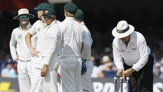 Australia's players watch a review screen after England's Jonny Bairstow was bowled by Australia's Peter Siddle, later declared a no ball by a review decision during the Ashes test at Lord's.