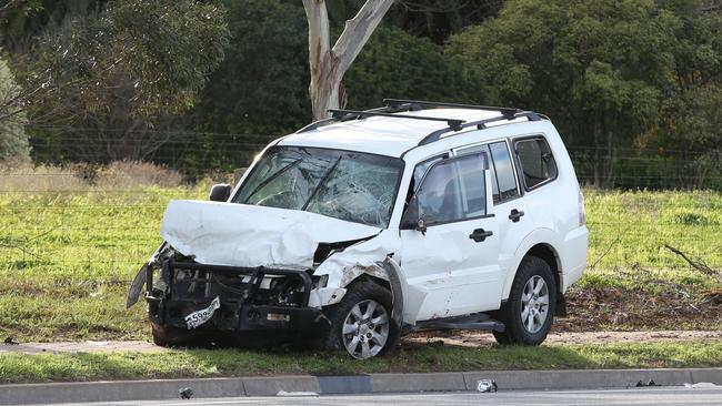 The stolen 4WD at the scene of the crash. Picture: AAP/Dean Martin)