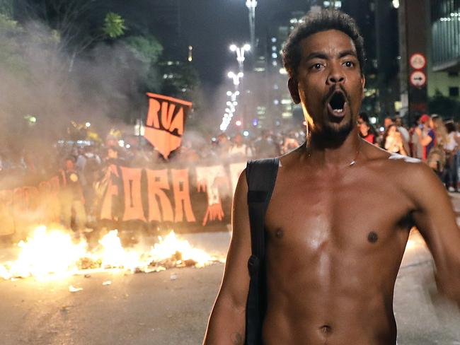 A demonstrator protests next to a barricade during a rally in support of Brazil's suspended President Dilma Rousseff and against acting President Michel Temer in Sao Paulo, Brazil. Picture: AP