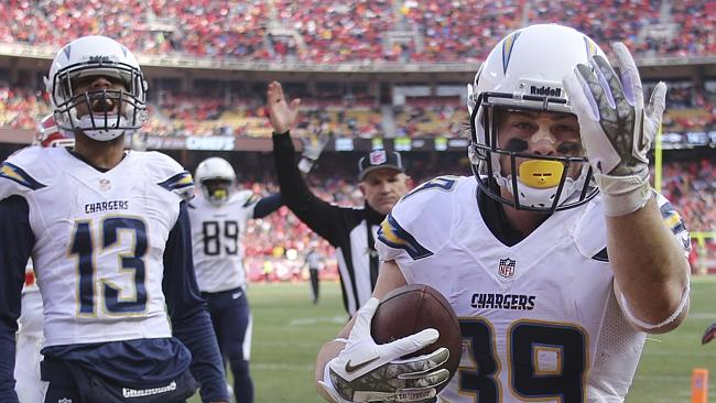 San Diego Chargers running back Danny Woodhead heads over to give a fan the ball after scoring a touchdown.