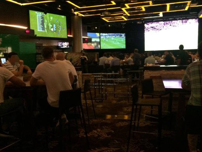 Patrons knock back beers as they would at any sports bar — except it's 3am.