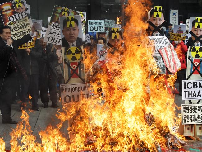 South Korean protesters burn an effigy of North Korea leader Kim Jong-un during an anti-North Korea rally on February 11, following the rocket launch.