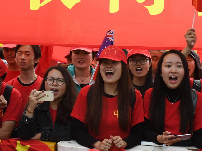 Supporters welcome Chinese Premier Li Keqiang to Parliament House in Canberra. Picture: AAP Image/Sam Mooy