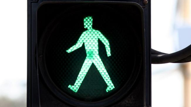 Green man means 'walk', red man means 'stop'.