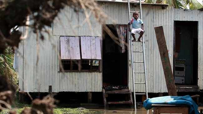Nabutu Settlement remains flooded as the clean-up begins and many people are homeless. Picture: David Geraghty