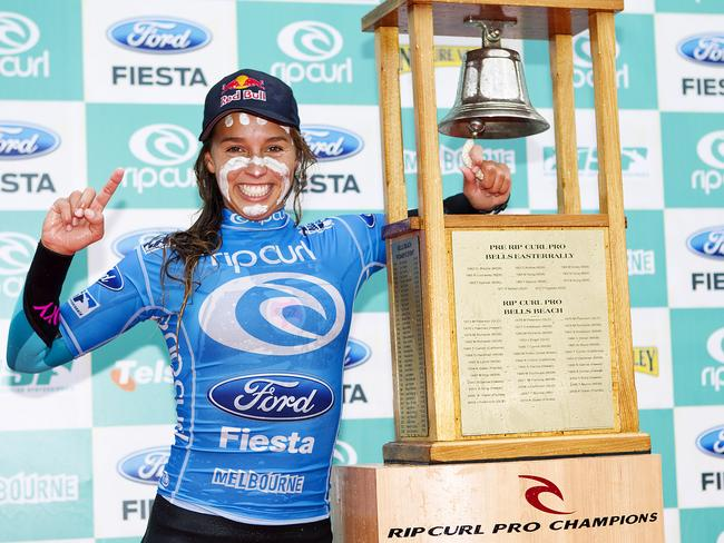 Sally Fitzgibbons with the trophy she won - and rang - when just 20. .