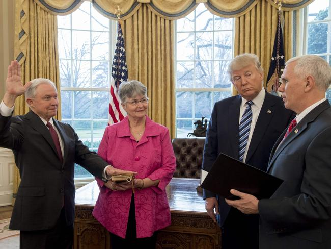 Donald Trump watches as Jeff Sessions alongside his wife Mary, is sworn in as Attorney-General by Mike Pence in the Oval Office. Picture: AFP