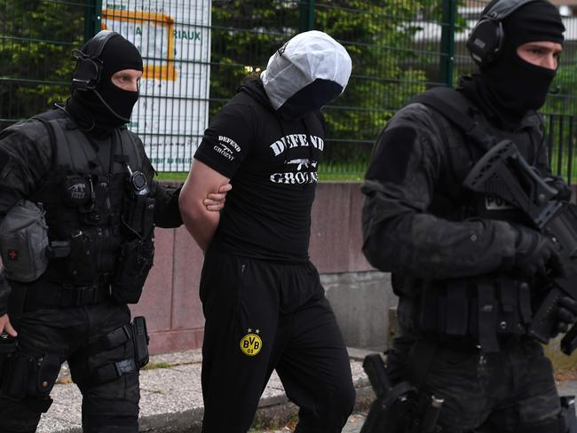 French police arrest a man in Strasbourg suspected to be linked to the Chechnya-born killer. Picture: AFP Photo/Patrick Hertzog