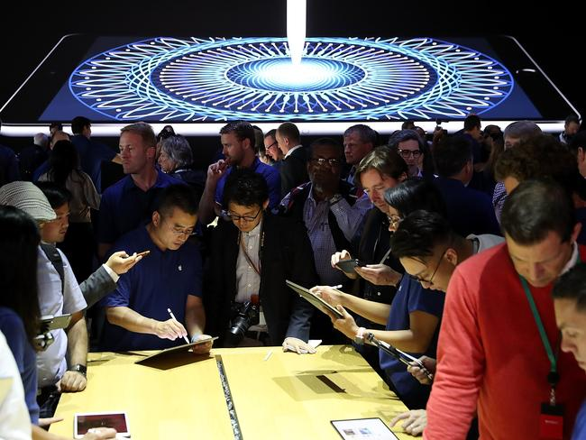 Attendees inspect the new iPad Pro during the 2017 Apple Worldwide Developer Conference. Picture: Getty/AFP