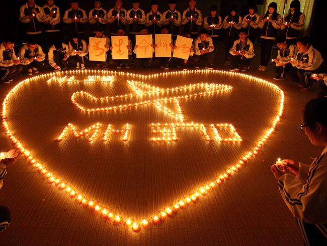 The plane that just disappeared ... students from an international school in Zhuji, China, pray for the passengers on-board Malaysia Airlines flight MH370.
