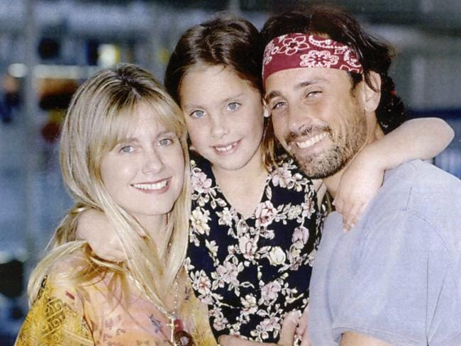 Family matters ... Olivia Newton-John, with daughter Chloe and then husband Matt Lattanzi, arrive at Sydney Airport in 1993.