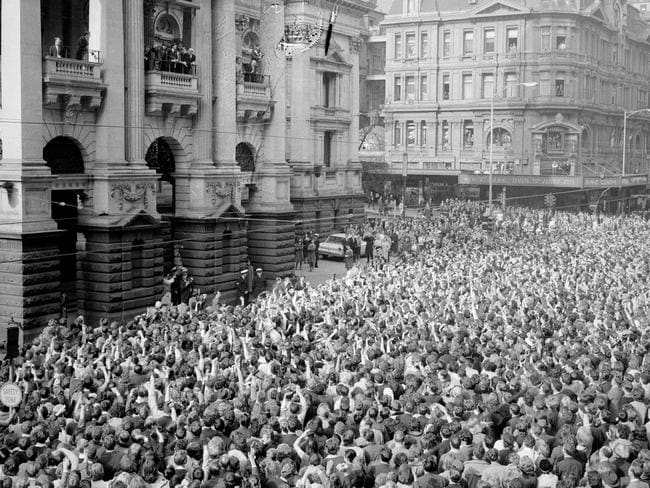 Fans unite . the massive crowd outside Melbourne Town Hall when The Beatles arrived for their State reception.