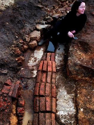 Archaeologist Mary Casey at the site of a convict-built road and drain at the Conservatorium of Music. Picture: Picture: Jeff Darmanin