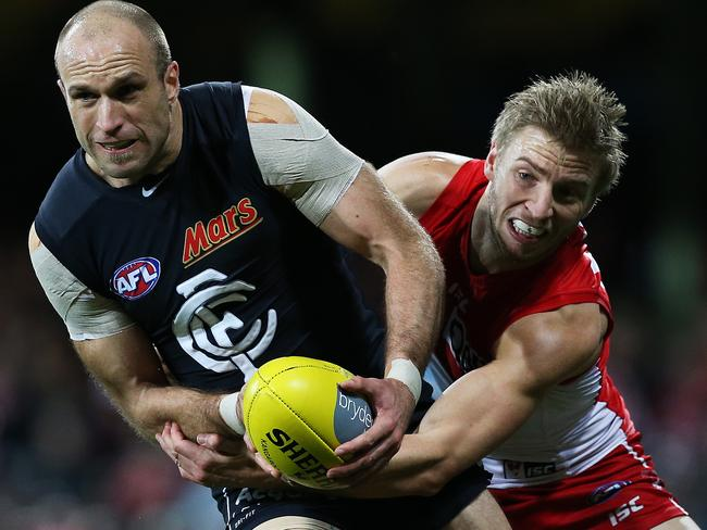 Kieren Jack puts the clamps on Chris Judd. pic. Phil Hillyard