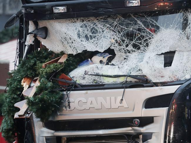 A Christmas decoration stuck in the smashed window of the cabin of a truck which ran into a crowded Christmas market in Berlin in December 2016. Picture: AP.