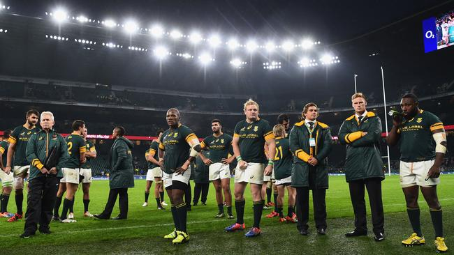 South African players show their dejection after the loss to England at Twickenham Stadium.