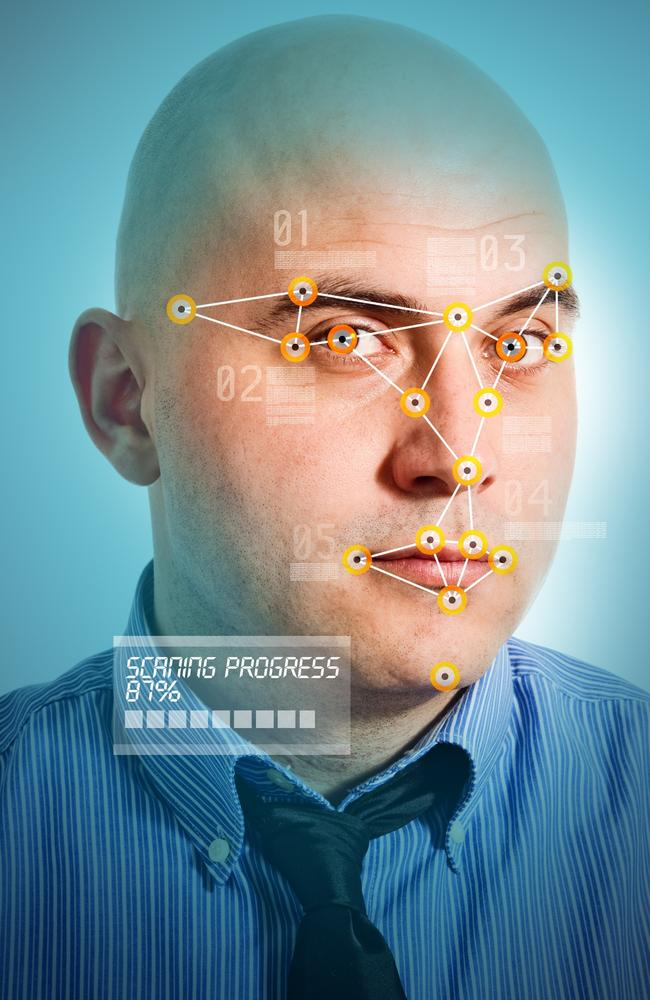 Face detection software recognising a face of young adult man.