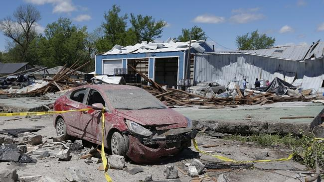 Tornado damage is surveyed in Quapaw, Oklahoma, Monday, April 28, 2014. Picture: AP