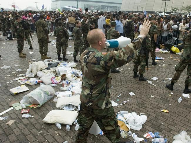 A Louisiana Army National Guard officer pleads for evacuees to stop from pushing forward during relief efforts at the Superdome in New Orleans, after the 2005 Hurricane Katrina disaster. The impact of an EMP attack would be far worse. Picture: AP