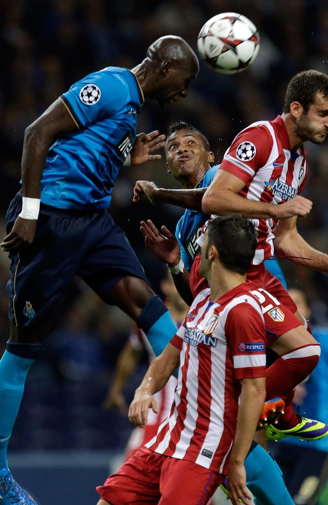 FC Porto's Eliaquim Mangala wins a header in a Champions League match against Atletico de Madrid.