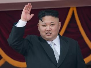 (FILES) This file photo taken on April 15, 2017 shows North Korean leader Kim Jong-Un waving from a balcony of the Grand People's Study house following a military parade marking the 105th anniversary of the birth of late North Korean leader Kim Il-Sung, in Pyongyang. Before tens of thousands of soldiers and civilians marched before him, along with some of the most fearsome weapons at his command, North Korean leader Kim Jong-Un and his audience were shown portraits of his grandfather and father. / AFP PHOTO / ED JONES / To go with NKOREA-POLITICS-DIPLOMACY-FESTIVAL, FOCUS by Sebastien Berger