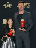 The MTV Movie and TV Awards are known for being over the top. Check out all the action at this years bigger and better-than-ever show... Dafne Keen stands with actor Hugh Jackman in the press room during the 2017 MTV Movie and TV Awards at the Shrine Auditorium in Los Angeles, California, May 7, 2017. Picture: AFP